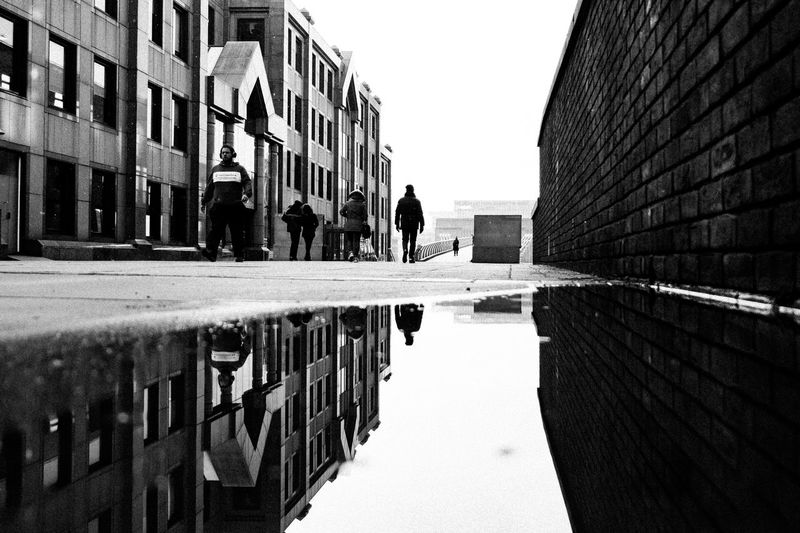 Let me know what I could do Outdoors Architecture Fujifilm_xseries Streetphotography Built Structure Building Exterior Reflection Water Building City Day Nature Puddle Sky Real People Men Walking Footpath People Wall Group Of People Incidental People Canal