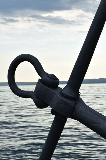 Far shore of the Garda Lake seen from Bardolino through the top of a huge, monumental anchor. EyeEmNewHere GARDA Lake 🌞 Anchor Beauty In Nature Close-up Cloud - Sky Dusk Focus On Foreground Garda Lake Garda Lake Italy Italy Italy❤️ Metal Nature No People Outdoors Representation Scenics - Nature Shore Shoreline Sky Water The Traveler - 2018 EyeEm Awards