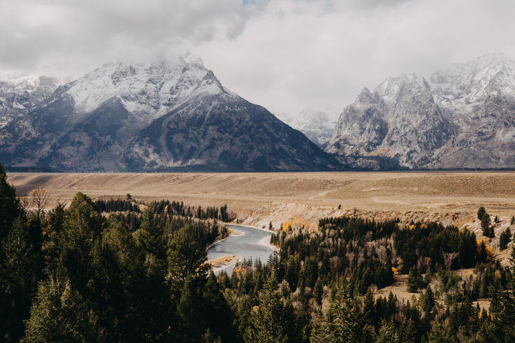 Grand Teton National Park  Grand Tetons Grand Teton National Park, Wyoming Wyoming Wyoming Landscape Us National Park Snake River Snake River Valley Snake River Overlook Snake River,Grand Tetons River Mountain Range Mountain Scenics - Nature Beauty In Nature Environment Sky Landscape Nature Cloud - Sky No People Tranquil Scene Day Tranquility Outdoors Snowcapped Mountain Snow Mountain Peak Non-urban Scene