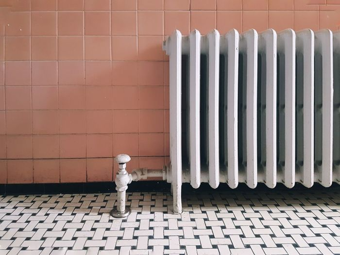 Metal radiator against wall