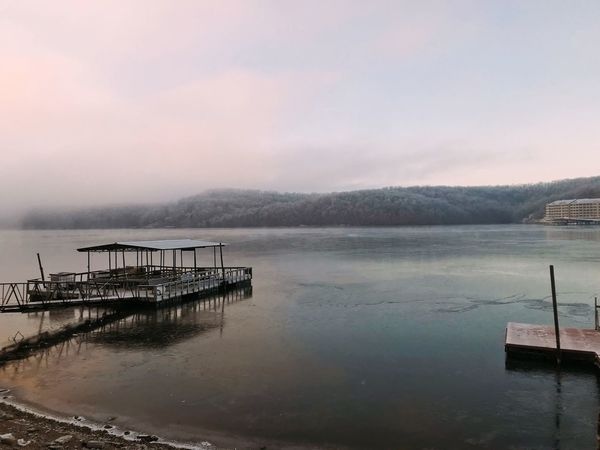 Frozen lake in February Cold Tranquil Calm Placid  Shoreline Ice Frozen Winter Docks Water Tranquility Scenics Beauty In Nature Tranquil Scene Nature Outdoors Sky No People Lake Day Fog