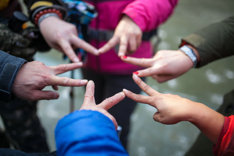 Friends making star shape with fingers