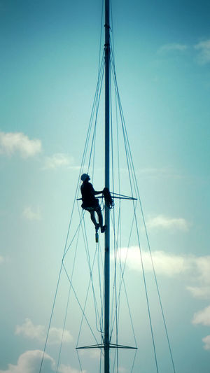 Low angle view of sailboat on pole against sky