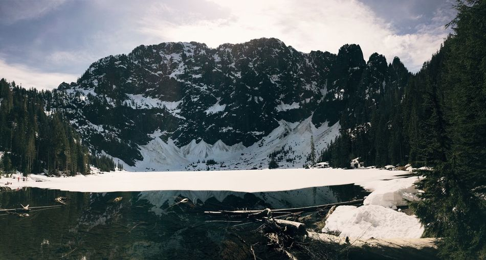 Taken at Lake Twenty Two. Beauty In Nature Cascade Mountains Cold Temperature Day Granite Falls Lake Lake Twen Mountain Mountain Range Nature No People Outdoors Pacific Northwest  Physical Geography Rocky Mountains Scenics Sky Snow Tranquil Scene Tranquility Water Winter The Great Outdoors - 2017 EyeEm Awards