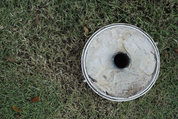 High angle view of hole on field