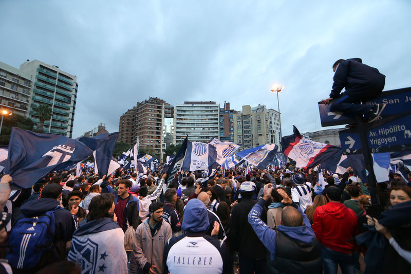 supporters club Talleres of Córdoba celebrate promotion to first division in a traditional corner of the city Argentina Celebration Cheers Fans Football Football Fever People Soccer Supporters