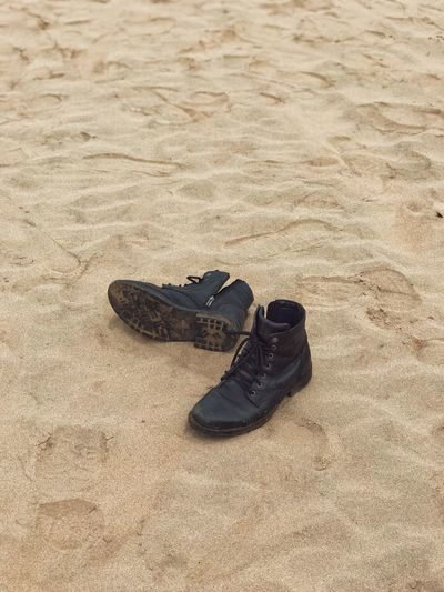High angle view of shoes on sand