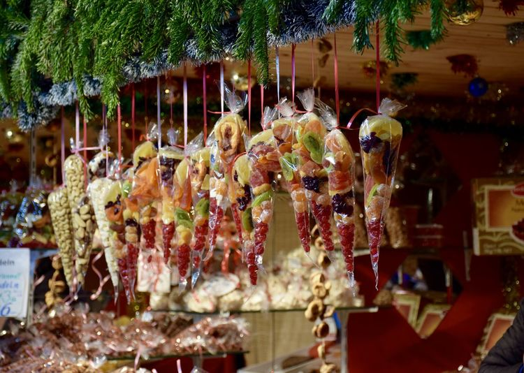 Close-up of dried fruits hanging for sale