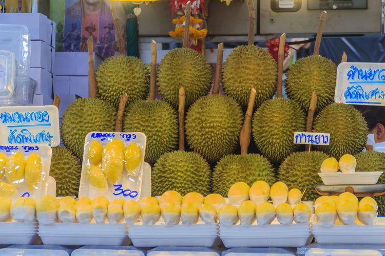 Bangkok, Thailand - April 23, 2017: Organic durian fruit and durian flesh packed for sale at Or Tor Kor Market, one of the world's fresh market that located nearby Chatuchak weekend market in Bangkok. Durian Durian Peel Durians Durian Fruit Durian Season Durianfestival Durians In Season Durians Shop