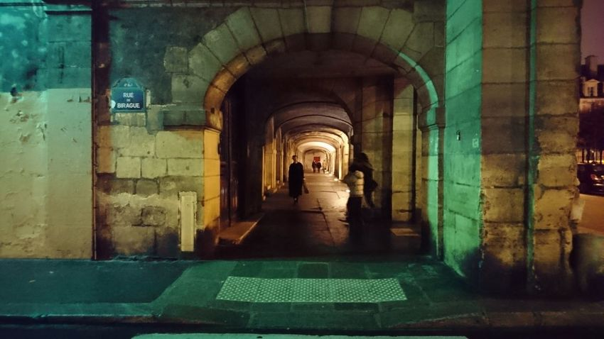 Passing through. Paris Paris ❤ France Europe Passing By Passing Through Sidewalk Pedestrian Walking Around Night Night Lights Night Colors Night Photography City Life Urban Life People Mystery The Night Water Arch Architectural Column Ancient Civilization Architecture