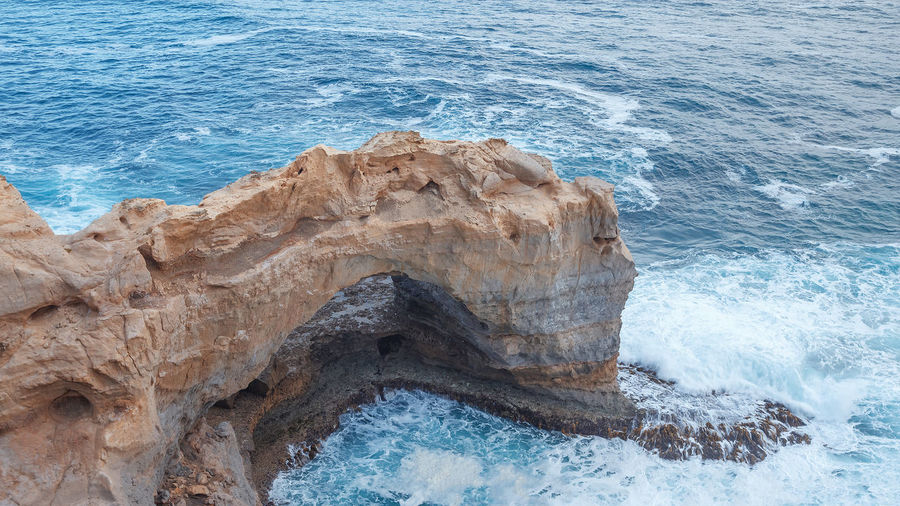 The Arch, Great Ocean Road Great Ocean Road Great Ocean Road, Australia Beauty In Nature Day Eroded Geology High Angle View Land Motion Nature No People Non-urban Scene Outdoors Rock Rock - Object Rock Formation Rocky Coastline Scenic View Scenics - Nature Sea Solid Sport Tranquility Water Wave