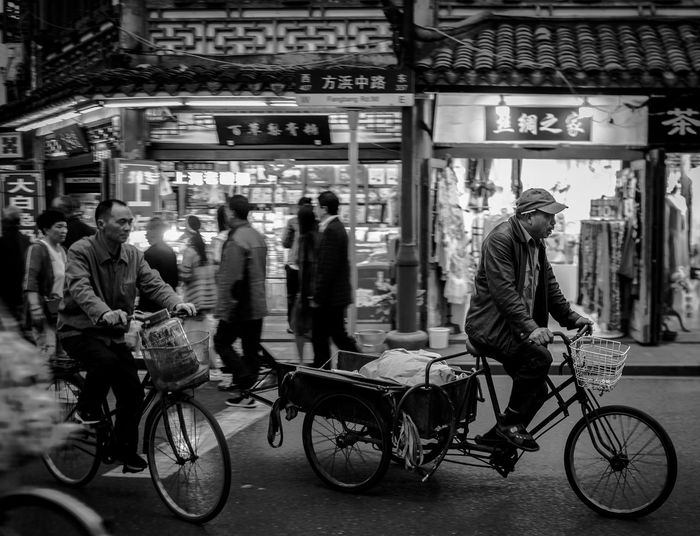 Black And White Street Photography Shanghai Streets Adult Bicycle Black And White Collection  Black And White Photography Blackandwhite City City Life City Street Group Of People Land Vehicle Lifestyles Men Mode Of Transportation People Real People Ride Riding Road Shanghai Street Photography Street Transportation