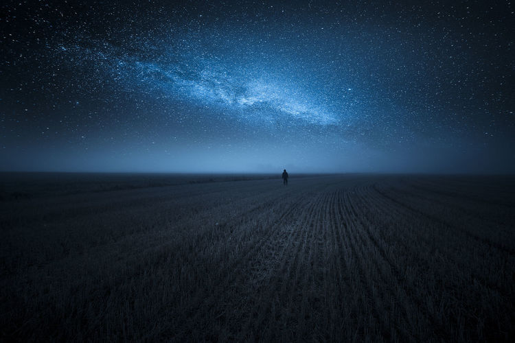 Person On Agricultural Field Against Star Field