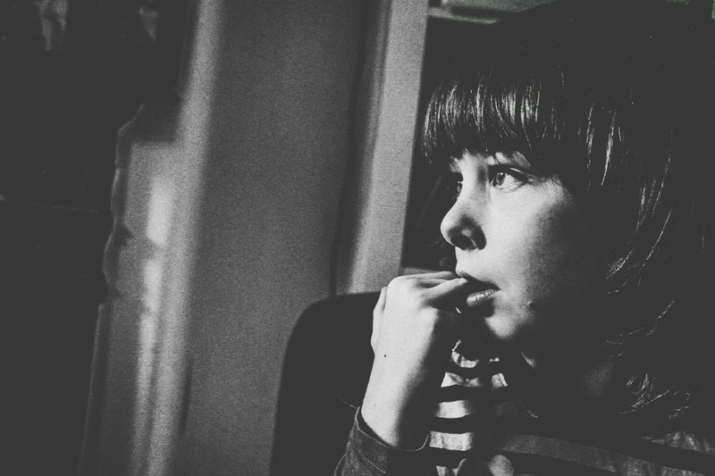 Close-Up Of Thoughtful Girl At Home