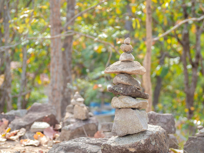 Stack of stones on rock in forest