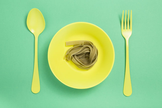 Abstract Close-up Concept Cutlery Directly Above Eating Utensil Food Food And Drink Food And Drink Fork Green Color Isolated Italian Pasta Minimalist Pasta Plate Saturated Silverware  Spoon Spoon Surreal Table Tagliatelle Vegetable Pasta Yellow