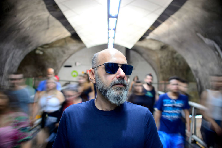 The Architect - 2019 EyeEm Awards EyeEm Best Shots Eye4photography  Getting Inspired My Best Photo Underground Notes From The Underground The Portraitist - 2019 EyeEm Awards Real People Indoors  One Person Portrait Slow Shutter Men Facial Hair Beard Front View Headshot Focus On Foreground Glasses Incidental People Lifestyles Adult Sunglasses Mid Adult Mid Adult Men