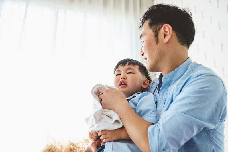 Father and son on baby