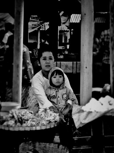 Here Belongs To Me At the traditional market INDONESIA Java IPhoneography Amateurphotography Tadaa Community Streetphotography Culture Local Wisdom Candid People Mother And Son Blackandwhite EyeEm Best Shots - Black + White Black And White Photography Woman Woman Portrait Woman Power Woman At Work