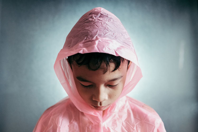 Raincoat Pink Color Portrait Boy Headshot Innocence Of Youth Youth Young Boy Looking Down Ready For Raining Day Raining People Lifestyle At Home A New Perspective On Life Capture Tomorrow