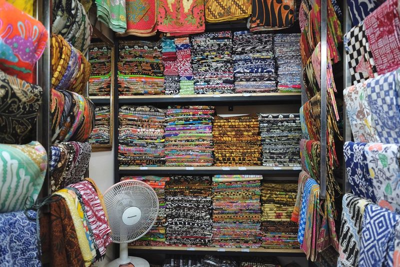 Batik Multi Colored For Sale Choice Retail  Market Variation Large Group Of Objects Backgrounds Textile Collection Small Business Store Business No People Full Frame Retail Display Market Stall Arrangement Abundance Pattern
