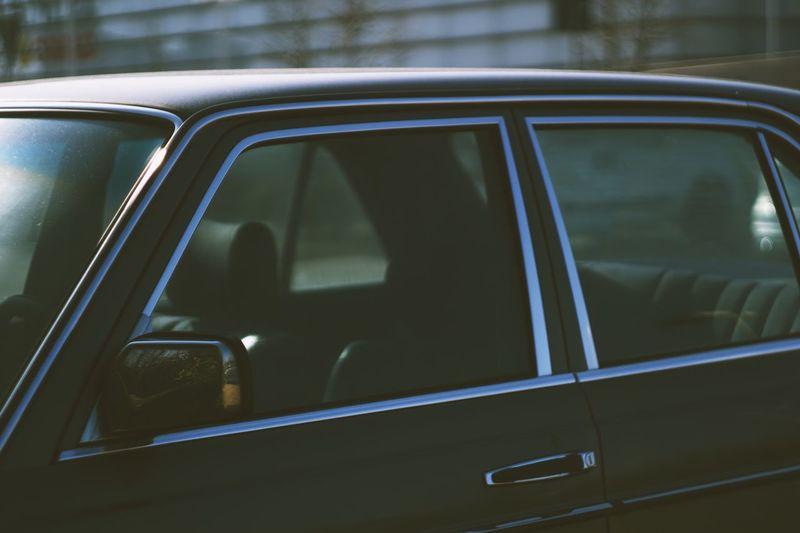 Black car in parking lot