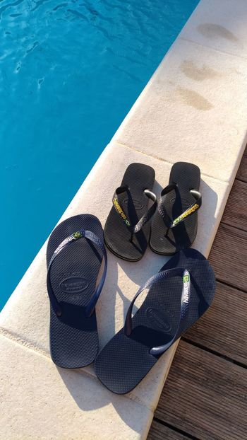 EyeEm Selects Swimming Pool Water No People Outdoors Day Tong Havaianas Sunlight Couple Lifestyles Shoes ♥ Blue Black
