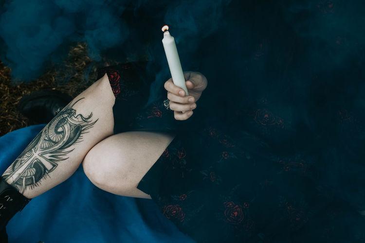 High angle view of woman smoking cigarette