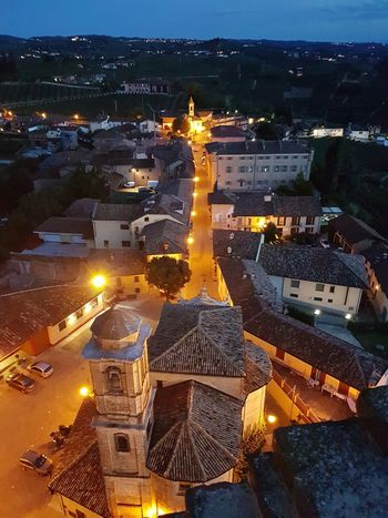 High Angle View Architecture Outdoors Illuminated No People Built Structure Building Exterior Night Sea Travel Destinations Cityscape City Water Sky Nature Astronomy Langhe Piedmont Italy Panoramic View Tourism Aerial View Cityscape Summer Evening Lights