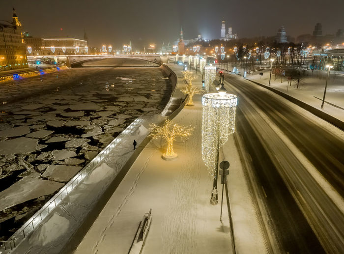 Aerial view of illuminated city during winter