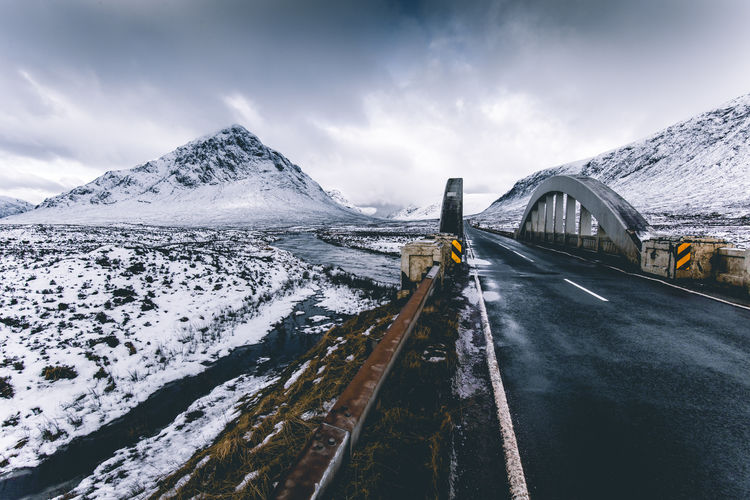 Winter snow landscape in Glencoe, Scotland, UK Winter Snow Mountain Snowcapped Mountain Scotland Uk United Kingdom Glencoe Scottish Highlands Landscape Dramatic Sky Clouds Cold Temperature Beauty In Nature Moody Road Journey Road Trip