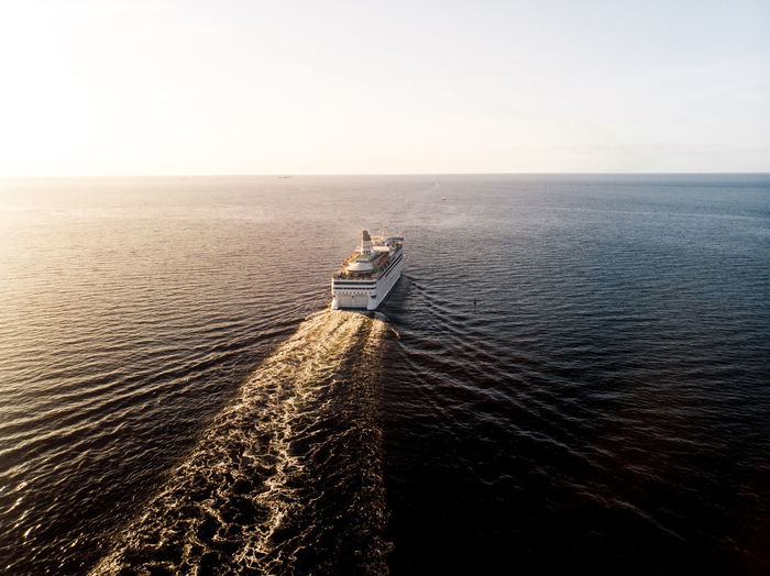High angle view of ship sailing on sea against sky