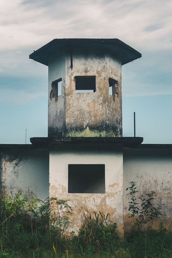 Abandoned prison at Dois Rios on Ilha Grande. Abandoned Architecture Building Exterior Built Structure Cloud - Sky Concrete Concrete Jungle Day Door Minimal Minimalism Nature Nature No People Outdoors Shapes Simple Photography Simplicity Sky Sky And Clouds Symmetrical Symmetry Water Window Windows The Architect - 2017 EyeEm Awards BYOPaper! The Photojournalist - 2017 EyeEm Awards EyeEm Selects EyeEmNewHere The Graphic City Visual Creativity The Architect - 2018 EyeEm Awards
