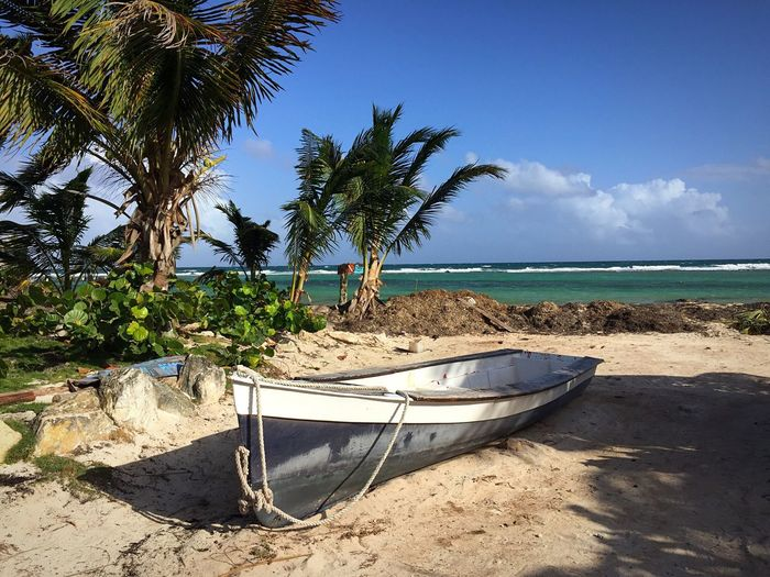 Scenic View Of Boat On Beach Against Sky