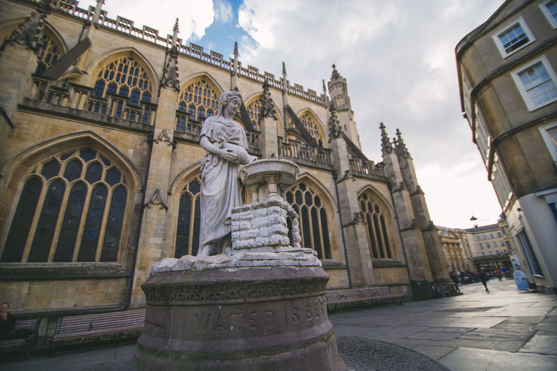 The Rebecca Fountain Statue outside of Bath Abbey Bath Abbey  Bath Uk City Of Bath Fountain Rebecca Fountain Sculpture Statue Of Water Goddess The Rebecca Fountain Statue Travel Destinations Water Is Best