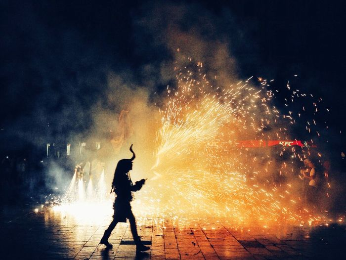 Night Firework Display Firework - Man Made Object Exploding Full Length Outdoors Arts Culture And Entertainment Real People Celebration Standing Men Motion One Person Protective Workwear Sky People Adult EyeEmNewHere Paint The Town Yellow
