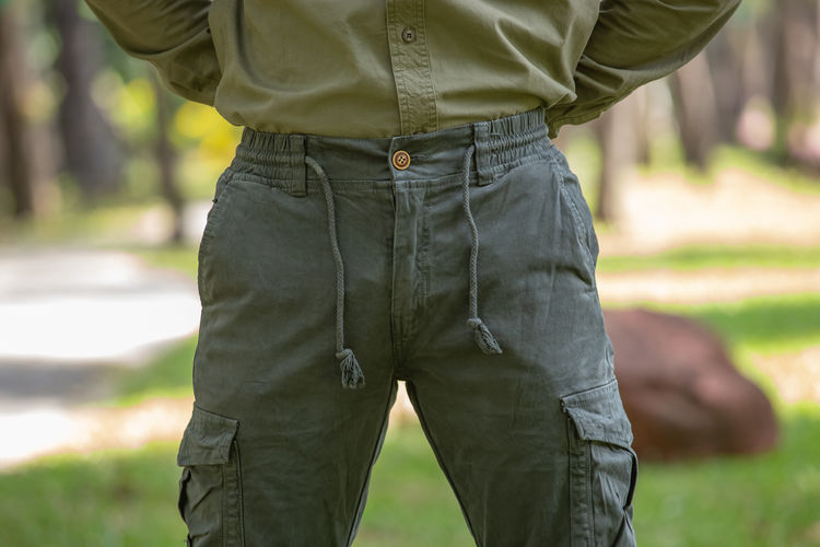 Midsection of man standing on field