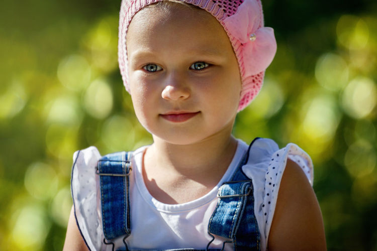 Blue Casual Clothing Childhood Close-up Cute Day Focus On Foreground Front View Green Color Headshot Innocence Leisure Activity Lifestyles Outdoors Person Portrait Selective Focus