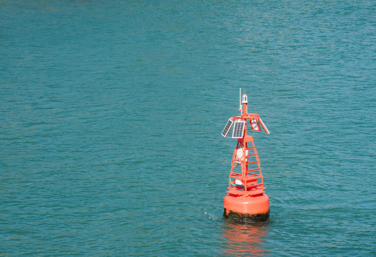 Marine buoy in the Pacific Ocean in Tauranga, New Zealand Harbour Isolated Nature Oceanography Pacific Solar Solar Panel Tauranga Turquoise Colored Buoy Collection Data Device Environment Environmental Conservation Marine New Zealand Object Ocean Oceanographic Outdoors Rippled Sea Solar Energy Technology