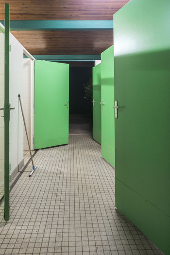 Green Doors Of Toilet In Building