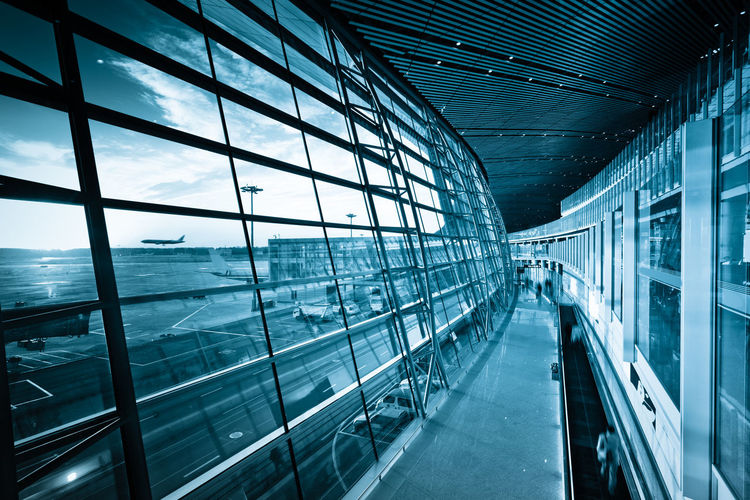 View of airport seen through glass window