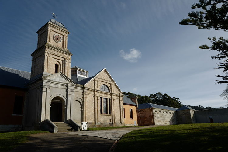 Shot in Tasmania, Australia. Architecture Bell Tower Building Exterior Built Structure Cloud - Sky Day Grass History No People Outdoors Place Of Worship Religion Sky Spirituality Tree