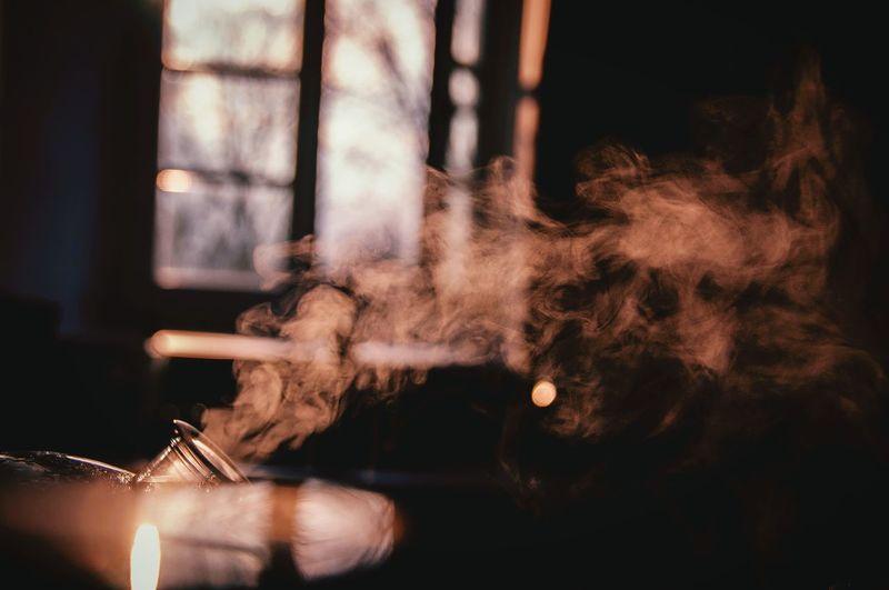 Smoke Emitting From Vaporizer Against Window