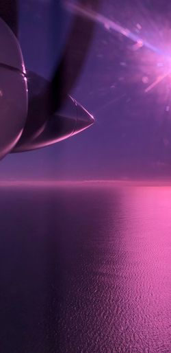 Abstract image of airplane flying over sea at night