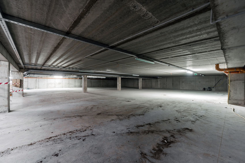 Inside of empty underground parking Ceiling Parking Garage Parking Lot Underground Parking Lot Building Built Structure Empty Floor Garage Gray Grey Illuminated Indoors  Inside No People Nobody Parking Parking Area Parking Garage Underground Parking