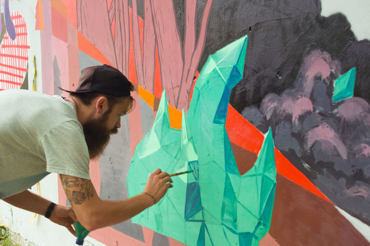 Abstract Adult Art Art And Craft Artistic Capture The Moment Casual Clothing Colorful Creative Creativity Creativity Fantasy Freedom Graffiti Hands At Work Lifestyle Lifestyles Man Painting Spray Paint Street Photography Wall Wall Art Youth Culture Youth Of Today
