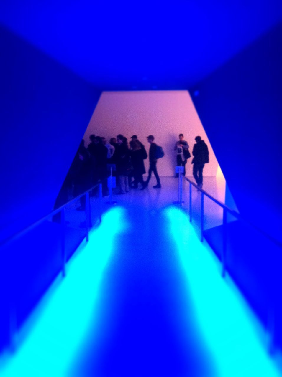 indoors, real people, blue, staircase, lifestyles, men, modern, standing, architecture, women, togetherness, friendship, day, people