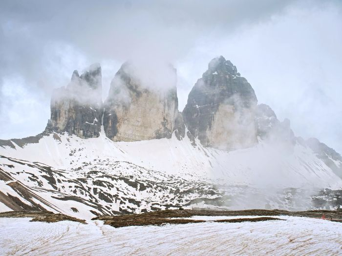 North side of sexten dolomites symbol - tre cime. may view from popular trail around the rocks