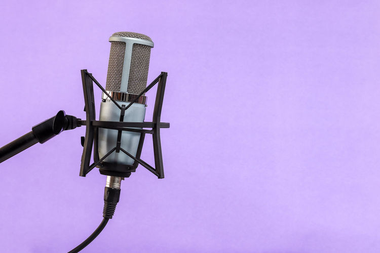 Microphone on Violet background No People Pink Color Technology Copy Space Studio Shot Colored Background Metal Indoors  Low Angle View Equipment Lighting Equipment Purple Single Object Arts Culture And Entertainment Cable Connection Electricity  Retro Styled Electrical Equipment