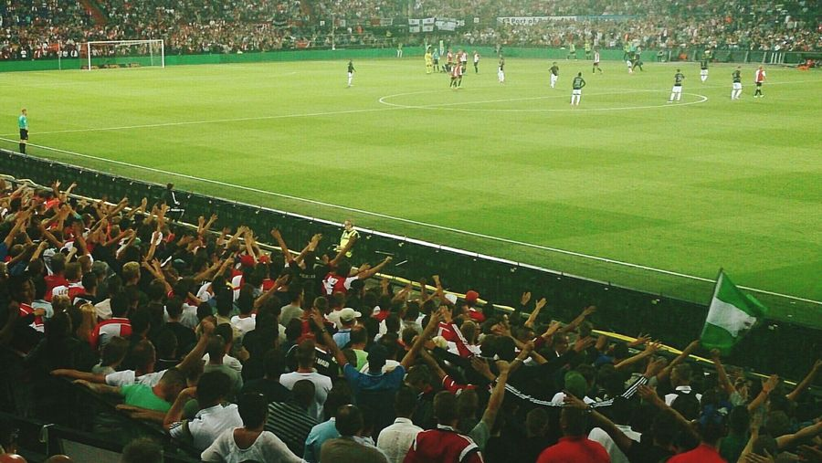 The Fan Club Supporters of Feyenoord Rotterdam cheer at the First Match of the season. Feyenoord won with 3 to 2 from Fc Utrecht (c) 2015 Shangita Bose All Rights Reserved
